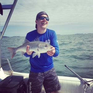 """Eric holding up a 32"""" Striped Bass"""