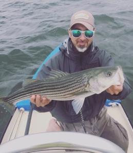 Fall striper fishing on the flats skiff