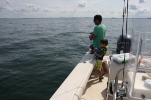 Father and Son hooked up jigging mackerel