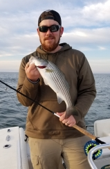 Ryan's first striped bass on the fly - Cape Cod 2019